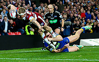 Wigan Warriors' Dominic Manfredi goes over to score his side's third try under pressure from Warrington Wolves 's Tom Lineham<br /> <br /> Photographer Alex Dodd/CameraSport<br /> <br /> Betfred Super League Grand Final - Wigan Warriors v Warrington Wolves - Saturday 13th October 2018 - Old Trafford - Manchester<br /> <br /> World Copyright &copy; 2018 CameraSport. All rights reserved. 43 Linden Ave. Countesthorpe. Leicester. England. LE8 5PG - Tel: +44 (0) 116 277 4147 - admin@camerasport.com - www.camerasport.com