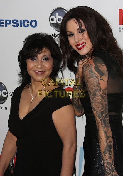 GUEST & KAT VON.The 2009 Alma Awards held at Royce Hall at UCLA in Westwood, California, USA. .September 17th, 2009 .half length black dress sheer leather  tattoos .CAP/ADM/CH.©Charles Harris/AdMedia/Capital Pictures