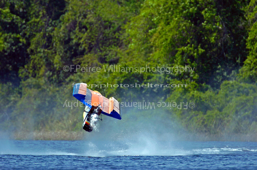 Frame 18: Michael Floyd, #71, blows his SST-120 boat over on a qualifying lap, landing upside down and getting himself out safely without injury.