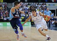 GB's Devon Van Oostrum on the move past Nemanja Gordic of Bosnia & Herzegovina during the EuroBasket 2015 2nd Qualifying Round Great Britain v Bosnia & Herzegovina (Euro Basket 2nd Qualifying Round) at Copper Box Arena in London. - 13/08/2014
