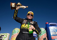 Sep 29, 2013; Madison, IL, USA; NHRA pro stock driver Erica Enders celebrates after winning the Midwest Nationals at Gateway Motorsports Park. Mandatory Credit: Mark J. Rebilas-