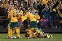 MELBOURNE, 11 JUNE 2013 - Lucas NEILL and Mark Bresciano of Australia celebrate a goal by Robbie Kruse in a Round 4 FIFA 2014 World Cup qualifier match between Australia and Jordan at Etihad Stadium, Melbourne, Australia. Photo Sydney Low for Zumapress Inc. Please visit zumapress.com for editorial licensing. *This image is NOT FOR SALE via this web site.