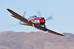 Owned by the Sanders family and piloted by Matt Jackson Race 8, Dreadnought, heads into the Valley of Speed during the 2006 Reno Championship Air Races. Matt piloted the modified Hawker Sea Fury to a second place finish with a speed of 453.559 mph over 67.29 miles in the Unlimited Gold Championship race. Photographed 09/06