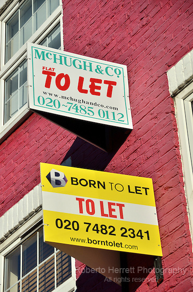 To Let estate agent boards outside a first floor flat, London, UK.