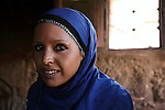 Portrait of  a young Bedouin woman in Petra, Jordan. Petra is the most visited tourist attraction in Jordan, a symbol of the country for its historical and archaeological importance. It has been a UNESCO World Heritage Site since 1985. The Bedouin families that have been living for centuries in the caves of Petra, agreed to move out into a small village, built near the site of Petra. Most of them earn their living from tourism which seems to be the only option available, especially for the younger generations.