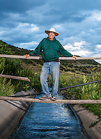 Joe Gallegos on his land near The People's Ditch in San Luis, Colorado, Monday, August 17, 2015. The People's Ditch is the oldest continually used ditch in Colorado. Joe's family has used the ditch for five generations. The People's Ditch was initially a shallow hand-dug irrigation channel. Later, oxen pulling a plow widened and extended the ditch. Operating under Water District 24 of Division 3, the People's Ditch holds the first adjudicated water rights in Colorado.<br /> <br /> <br /> Photo by Matt Nager