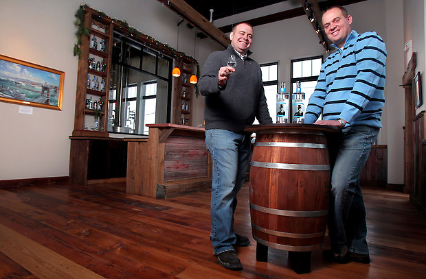 Garrett Burchett, left, and brother Ryan have launched Iowa's newest liquor distillery in a bid to win the hearts and palettes of Iowans looking for good, locally grown liquor. Mississippi River Distilling Co., based in Le Claire, Ia., hopes to sell roughly 5,000 cases per year of vodka, gin and bourbon made solely out grain grown within 25 miles of their plant.