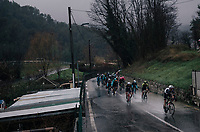 (What's left of) the peloton making a splash; torrential rain makes manouvering in the descents extremely tricky (with water even coming out of the putholes)<br /> <br /> 76th Paris-Nice 2018<br /> Stage 8: Nice > Nice (110km)