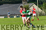 Killarney Legion Denis Sheahan in possession of the ball tackled by West Kerry PJ Mac Lamh during the County Senior Football Champhionship Round 2A match at Paddy Kennedy Memorial Park, Annascaul, on Sunday afternoon.