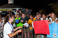 Fans look for the autograph of Portland Thorns forward Alex Morgan (13) after the match. The Portland Thorns defeated the Western New York Flash 2-0 during the National Women's Soccer League (NWSL) finals at Sahlen's Stadium in Rochester, NY, on August 31, 2013.