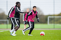 Wednesday  27 April 2016<br /> Pictured: Bafetibi Gomis of Swansea City  and Jefferson Montero of Swansea City  in action during training<br /> Re: Swansea City Training Session at the Fairwood Ground, Swansea, Wales, UK