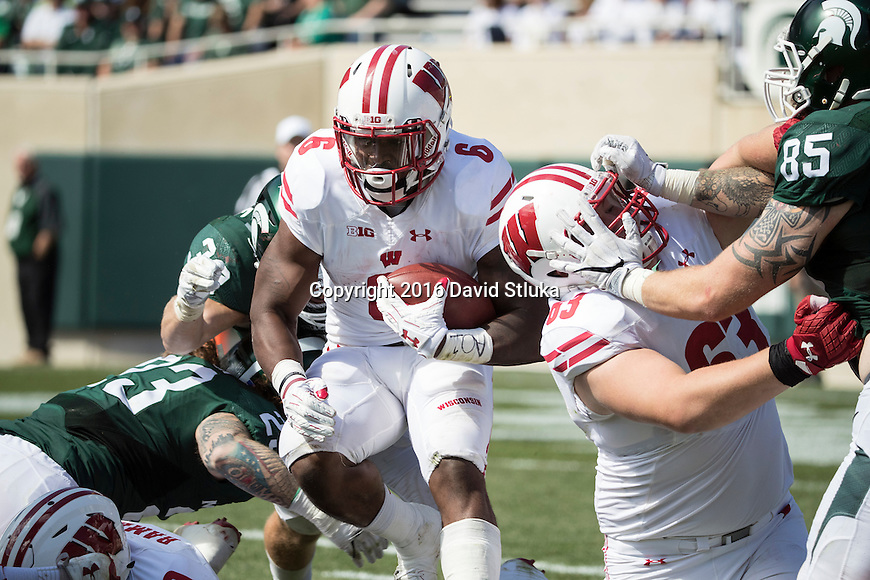 Wisconsin Badgers running back Corey Clement (6) carries the ball during an NCAA college football game against the Michigan State Spartans Saturday, September 24, 2016, in East Lansing, Michigan. The Badgers won 30-6. (Photo by David Stluka)