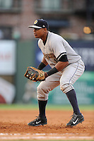 First baseman Isaias Tejeda (19) of the Charleston RiverDogs plays the infield in a game against the Greenville Drive on Monday, June 29, 2015, at Fluor Field at the West End in Greenville, South Carolina. Greenville won, 4-2. (Tom Priddy/Four Seam Images)