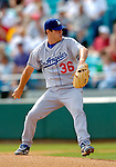 11 March 2006: Lance Carter, pitcher for the Los Angeles Dodgers, winds up on the mound during a Spring Training game against the Washington Nationals. The Nationals defeated the Dodgers 2-1 in 10 innings at Space Coast Stadium, in Viera, Florida...Mandatory Photo Credit: Ed Wolfstein.