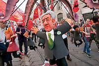 """Milano, """"Occupyamo Piazza Affari"""", manifestazione di protesta di partiti e organizzazioni di estrema sinistra contro la crisi economica e i provvedimenti messi in atto dal governo. Il pupazzo del Presidente del Consiglio Mario Monti --- Milan, """"Occupy Piazza Affari"""", demonstration of  extreme left parties and organizations to protest against the  economic crisis and the Government. The puppet of Prime Minister Mario Monti"""