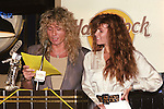 David Coverdale of Whitesnake and wife Tawny Kitaen appear at a MTV Press Conferencece for the MTV Awards at the Hard Rock Cafe in New York