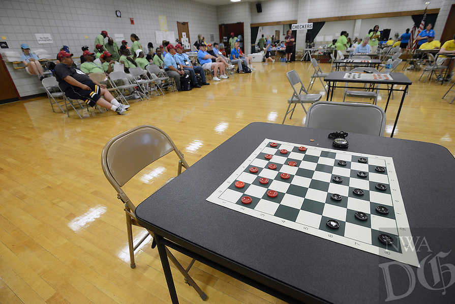 STAFF PHOTO SAMANTHA BAKER &yen; @NWASAMANTHA<br /><br />Athletes and spectators wait for more pairings to be called to play checkers Sunday, June 29, 2014, at the HPER building on campus in Fayetteville for the 28th annual National Veterans Golden Age Games. Dominos, checkers and table tennis were events scheduled for Sunday. Monday's events will include horseshoes, bowling, swimming, checkers, dominos, and nine-ball. Badminton will also be played as an exhibition event.