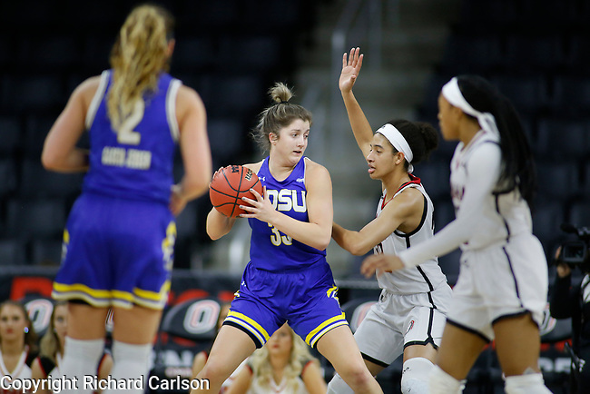 December 29, 2019; Omaha, NE, USA; Paiton Burckhard of South Dakota State works against Omaha defenders in Summit League women's basketball Sunday at Baxter Arena in Omaha, NE. (Photo by Richard Carlson)