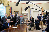 """United States President Donald Trump speaks during a National Economic Council meeting where he signed what he described as a """"permit"""" for the construction of the Keystone XL Pipeline in the Oval Office of the White House on March 24, 2017 in Washington, DC. <br /> Credit: Olivier Douliery / Pool via CNP"""