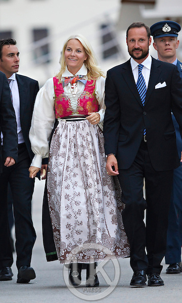 "Crown Prince Haakon and Crown Princess Mette-Marit of Norway leave the Royal Yacht, "" Norge "" to attend a dinner at Arendal town hall  during a  three day visit, to the county of Aust-Agder in Southern Norway.."