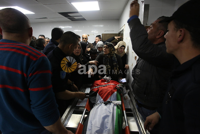 Relatives of two Palestinians Zead Al-Nori and Raed Hamdan, mourn over their bodies during their funeral in the West Bank on Nablus, on March 20, 2019. Israeli forces killed three Palestinians in two separate incidents on Tuesday night, Palestinian health ministry and emergency services said. Photo by Shadi Jarar'ah