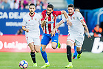 Yannick Ferreira Carrasco (c) of Atletico de Madrid is challenged by Pablo Sarabia Garcia (l) and Sergio Escudero Palomo of Sevilla FC during their La Liga match between Atletico de Madrid and Sevilla FC at the Estadio Vicente Calderon on 19 March 2017 in Madrid, Spain. Photo by Diego Gonzalez Souto / Power Sport Images