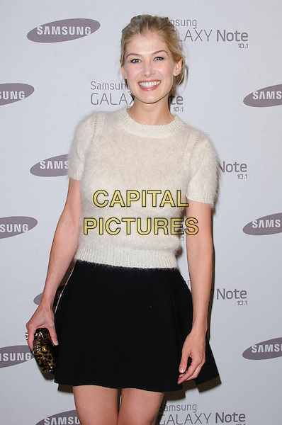 Rosamund Pike.Samsung celebrates the launch of the Galaxy Note 10.1 held at One Mayfair..London, England..August 15th, 2012.hlaf length sweater jumper black skirt clutch bag white knitted .CAP/CJ.©Chris Joseph/Capital Pictures.