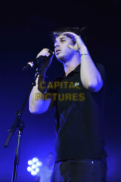 Mark Foster of Foster The People performing live in concert at Brixton Academy, London, England. .28th April 2012.on stage in concert live gig performance performing music half length black top  singing hand arm.CAP/MAR.© Martin Harris/Capital Pictures.