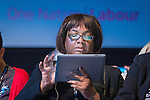 © Joel Goodman - 07973 332324 . 23/09/2013 . Brighton , UK . MP for Hackney North and Stock Newington , DIANE ABBOTT , on her iPad in the audience during the Work and Business session . Day 2 of the Labour Party 's annual conference in Brighton . Photo credit : Joel Goodman