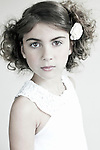 Female youth waring white dress looking at camera