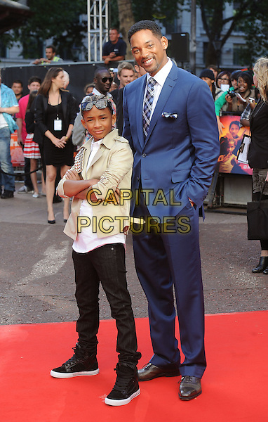 "JADEN SMITH & WILL SMITH.The Gala Premiere of ""The Karate Kid"", Odeon Leicester Square, London, England, UK..15th July 2010.full length father dad son family blue suit beige jacket shirt black trousers trainers hands in pockets arms crossed folded .CAP/BEL.©Tom Belcher/Capital Pictures."