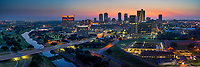 Another pano aerial image of Fort Worth Skyline right before sunrise with these wonderful colors of pinks, yellows, blues and purple in the sky.  This image captures the cityscape with the Trinity river as it curves around the downtown area with the seventh street bridge at dawn.
