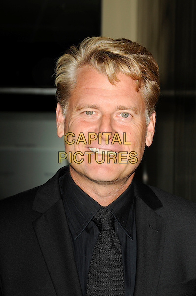 JOE SIMPSON.arriving at Operation Smile at the Beverly Hilton Hotel in Beverly Hills, California, USA, October 2nd 2009..portrait headshot black suit shirt tie smiling .CAP/ROT.©Lee Roth/Capital Pictures.