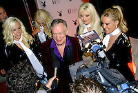 Rick Wilson Photo--2/5/05--Hugh Hefner with his Playboy bunnies at his side gives, interviews along the red carpet outside of River City Brewing Company Saturday evening upon entering Playboy's 6th annual Super Saturday night party in Jacksonville, Fl.