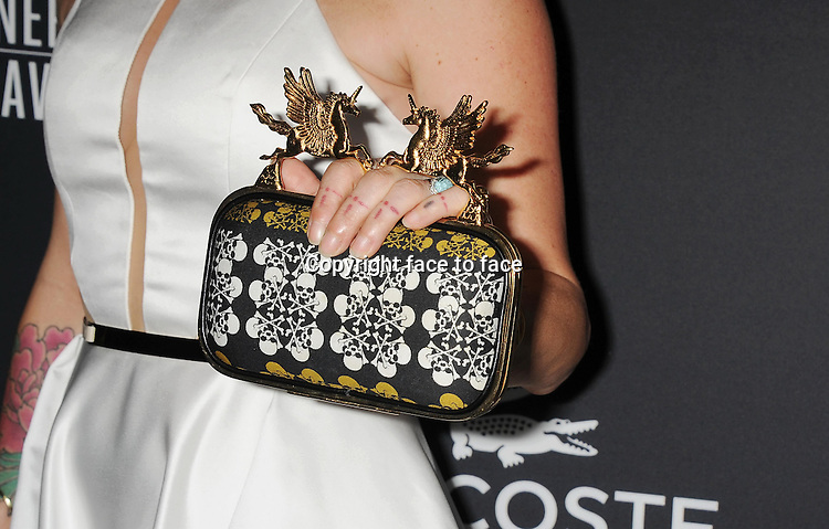 BEVERLY HILLS, CA- FEBRUARY 22: Costume designer Trish Summerville (handbag, bracelet, ring, tattoo detail) at the 16th Costume Designers Guild Awards at The Beverly Hilton Hotel on February 22, 2014 in Beverly Hills, California.<br />
