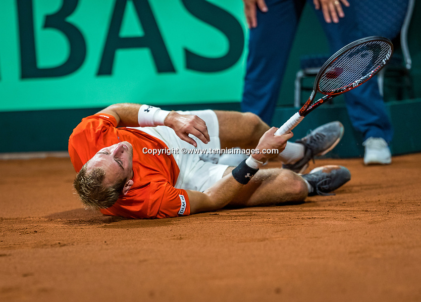 The Hague, The Netherlands, September 15, 2017,  Sportcampus , Davis Cup Netherlands - Chech Republic, First rubber: Thiemo de Bakker (NED) falling on the clay<br /> Photo: Tennisimages/Henk Koster