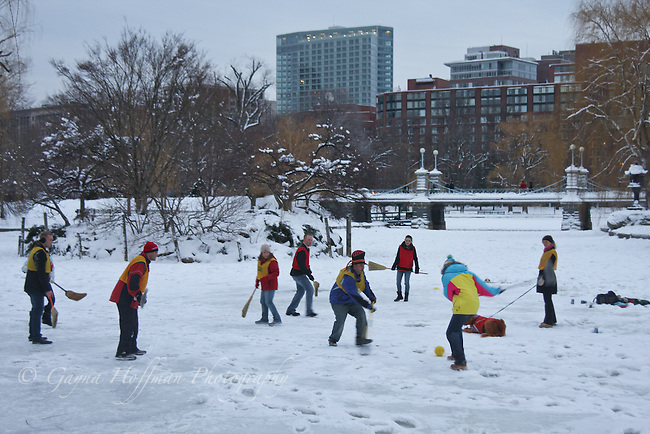 People playing broom hockey in the Boston Public Garden.