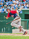 8 July 2014: Lowell Spinners outfielder Bryan Hudson lays down a bunt against the Vermont Lake Monsters at Centennial Field in Burlington, Vermont. The Lake Monsters rallied in the 9th inning to defeat the Spinners 5-4 in NY Penn League action. Mandatory Credit: Ed Wolfstein Photo *** RAW Image File Available ****