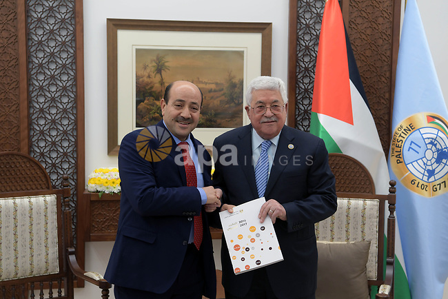 Palestinian president Mahmoud Abbas receives the annual report of the Staff Court in the West Bank city of Ramallah on February 5, 2019. Photo by Thaer Ganaim