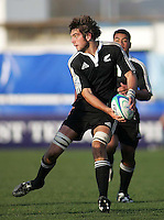 New Zealand second row Samuel Whitelock attacks the Welsh line during the Division A clash at Ravenhill. Result New Zealand 37 Wales 14.