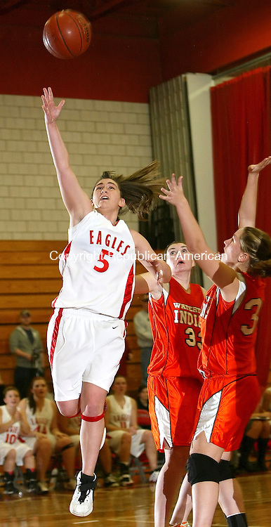 WOLCOTT, CT, 01/13/08- 011309BZ12-  Wolcott's Chrissie Benson  (5) goes to the hoop past Watertown's Hannah Collier (33) and Jennifer Barber(30) Tuesday night.<br />  Jamison C. Bazinet Republican-American