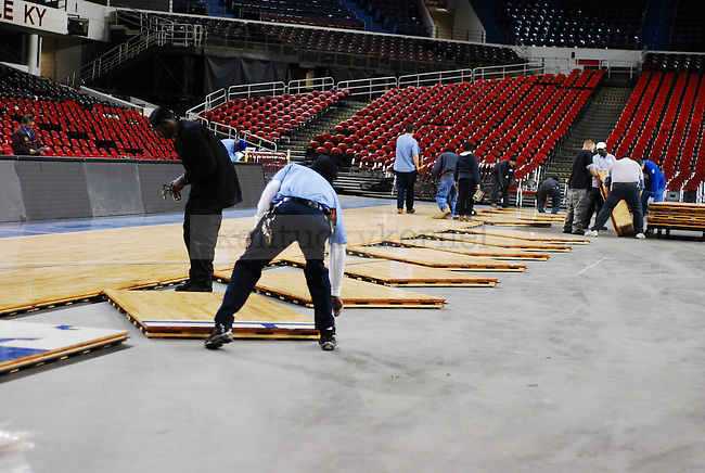 Kentucky Exposition Center staff assemble the basketball court at Freedom Hall on Monday December 5, 2010. Photo by Ryan Buckler | Staff