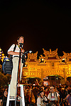 Donggang, Taiwan -- Photographer perched high for a better view of the King Boat at Donglong Temple.