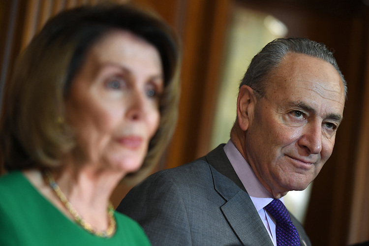 """UNITED STATES - APRIL 28: House Minority Leader Nancy Pelosi, D-Calif., and Senate Minority Leader Charles Schumer, D-N.Y., conduct a news conference in the Capitol's Rayburn Room titled """"President Trump's First 100 Days: A Budget of Broken Promises,"""" on April 28, 2017. (Photo By Tom Williams/CQ Roll Call)"""