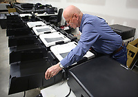 NWA Democrat-Gazette/DAVID GOTTSCHALK Larry Heiberger, a contract worker with Elections Systems and Software, assembles Wednesday, March 28, 2018, an Express Vote ballot marking device at the Benton County Election Commission in Rogers. Four hundred and seventy five devices and kiosks are being assembled for use in future elections.