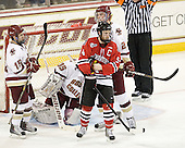 Joe Whitney (BC - 15), Tyler McNeely (Northeastern - 94), Brian Dumoulin (BC - 2) - The Boston College Eagles tied the visiting Northeastern University Huskies 7-7 on Friday, February 18, 2011, at Conte Forum in Chestnut Hill, Massachusetts.