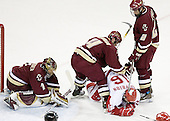 Cory Schneider 1 of Boston College secures the puck while Mike Brennan 4 and Anthony Aiello 2 of Boston College secure Blake Geoffrion 16 of the University of Wisconsin. The Boston College Eagles defeated the University of Wisconsin Badgers 3-0 on Friday, October 27, 2006, at the Kohl Center in Madison, Wisconsin in their first meeting since the 2006 Frozen Four Final which Wisconsin won 2-1 to take the national championship.<br />