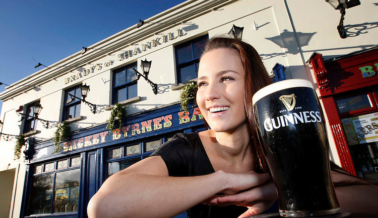 "NO FEE FOR REPRO..Pictured here is model Baibe toasting to the winners of the ""Guinness Unplugged"" competition from Brady's Pub in Shankhill, Co Dublin. ""Guinness Unplugged"" competition asked bars all around the country to capture their Arthur's Day celebrations, in a bid to win an exclusive gig with a top act. Following a thorough judging process, Brady's Pub in Shankhill, Co Dublin, has been crowned the winners entitling them to an exclusive gig in the pub with top Arthur's Day act, 'Noah And The Whale' in December. The entire bar, including the bar staff, the furniture, the decor and even the food was transported back to the 1700's, as tribute to Arthur Guinness and his enduring legacy. . Pic Robbie Reynolds / CPR."