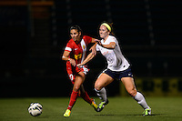 Western New York Flash midfielder Carli Lloyd (10) and Sky Blue FC midfielder Ashley Nick (12). The Western New York Flash defeated Sky Blue FC 2-0 during a National Women's Soccer League (NWSL) semifinal match at Sahlen's Stadium in Rochester, NY, on August 24, 2013.