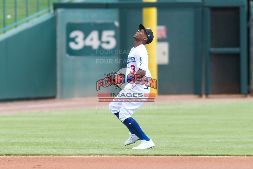 Glendale Desert Dogs shortstop Errol Robinson (3), of the Los Angeles Dodgers organization, tracks a pop up during an Arizona Fall League game against the Scottsdale Scorpions at Camelback Ranch on October 16, 2018 in Glendale, Arizona. Scottsdale defeated Glendale 6-1. (Zachary Lucy/Four Seam Images)